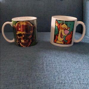Two oversized Disney mugs.